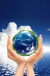 Hands and Earth. Symbol of environmental protection
