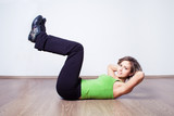 woman while abdominal training at home on the floor