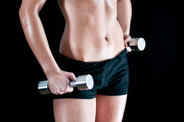 young woman doing a fitness workout with chrome dumbbells