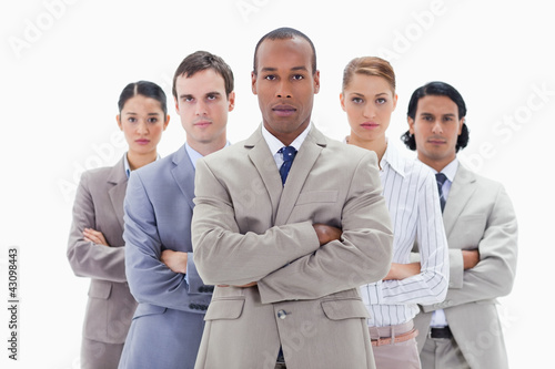 Close-up of a serious business team crossing their arms