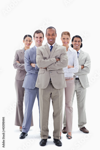 Smiling business team crossing their arms