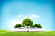 Book and big green tree for traveling and eco concept