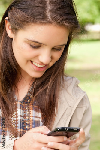 Close-up of a cute teenager using a smartphone