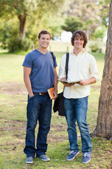 Portrait of two smiling male students posing