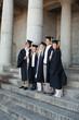 Graduates posing while smiling