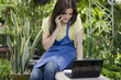Beautiful gardener taking an order on the phone