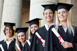 Close-up of five smiling graduates posing