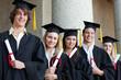 Close-up of five graduates students posing