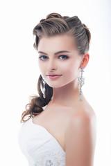 Slim beautiful woman fiancee in luxurious wedding dress