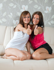women  showing thumb up