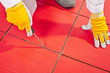 Sharp tool clean spaces between tiles remove tile adhesive debri