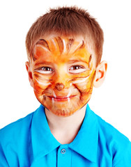 Child boy with paint of face.