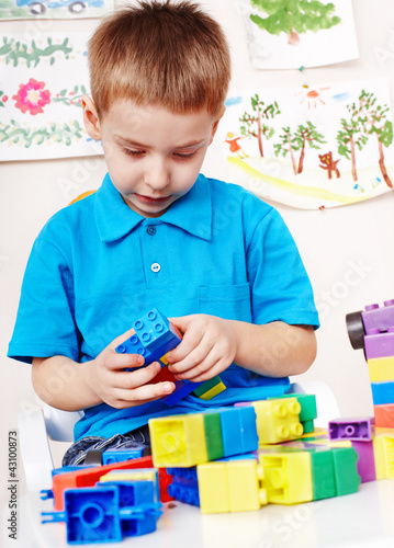 Child playing construction set.