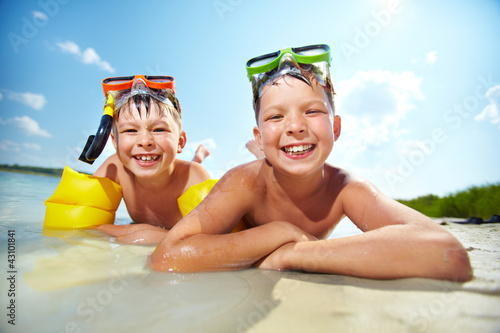 Siblings on beach