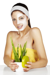 close up, woman's face with aloe, on white background
