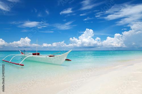 Leinwandbild Motiv White boat on a tropical beach