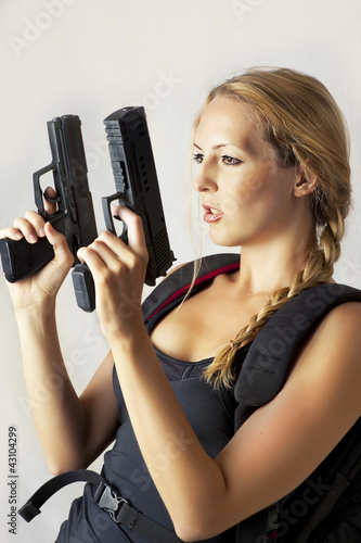 woman holding two hand gun