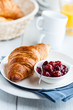 Croissant with sour cherry jam on a plate