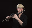 Portrait of a man playing ols wooden transverse flute