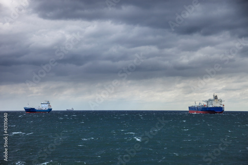 Two ships at sea and the upcoming storm.