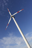 Wind Turbine with blue sky and the sun shining