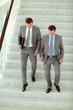 Businessmen walking downstairs in office building