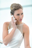 Blond executive woman talking on mobile phone