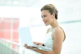Beautiful corporate woman working on laptop