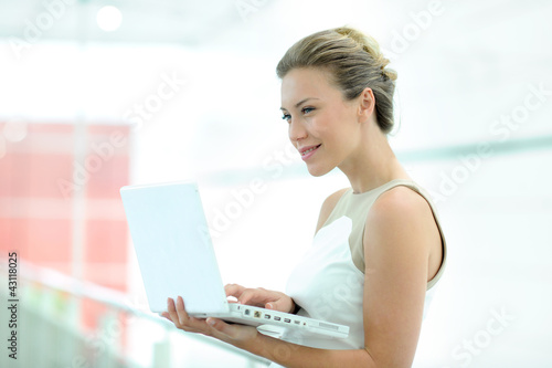 Beautiful corporate woman working on laptop