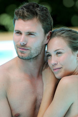 Closeup of couple bathing in swimming pool