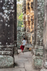Waiting amongst the ruined temples of Angkor Wat