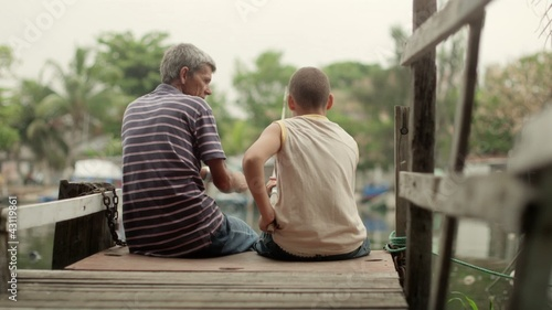 People and recreation, senior man and boy fishing on lake