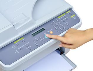 Hand pressing Start button on printer