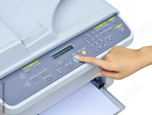 Hand pressing Start button on printer