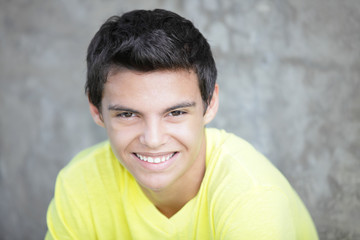 Image of a handsome young Hispanic teenager smiling