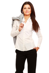 A businesswoman standing with a jacket on her shoulder