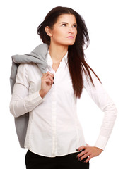 A businesswoman standing with a jacket