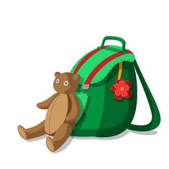 Schoolbag and teddy bear
