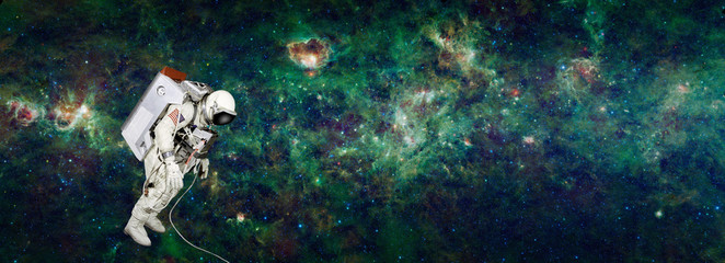Astronaut in space with milky way as background