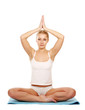 Young woman doing yoga , isolated on white background
