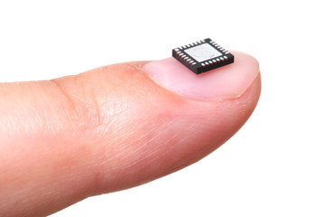 Computer microchip on girls fingernail