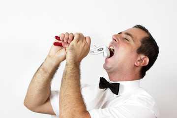 Guy with bow tie is trying to take out tooth with pliers