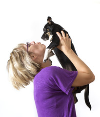 Young woman with dog in studio