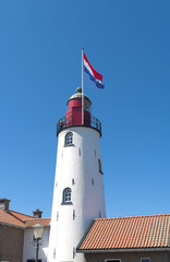 lighthouse with dutch flag on top