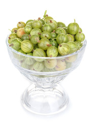 Green gooseberry in glass isolated on white