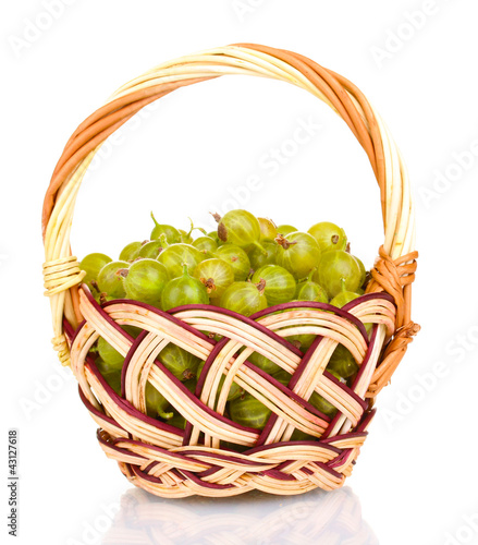 Green gooseberry in basket isolated on white