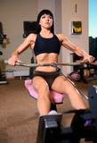 Attractive woman doing exercises at the gym