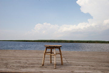 stool on wood pier front of the Danube Delta