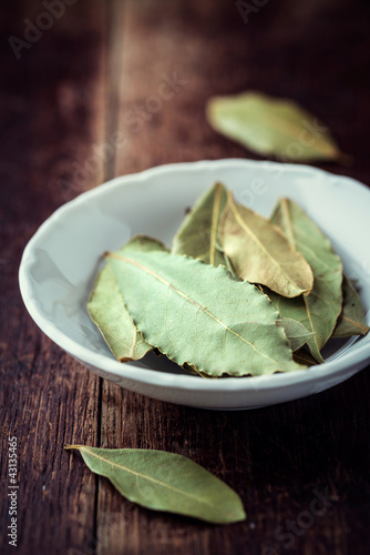 Bay leaves in a small bowl