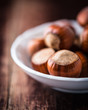 Close up of hazelnuts in a small bowl